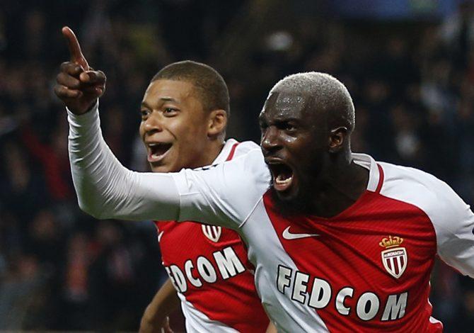 Monaco's Tiemoue Bakayoko celebrates with Kylian Mbappe-Lottin.