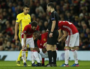 Manchester United's Paul Pogba sustains an injury before being substituted.
