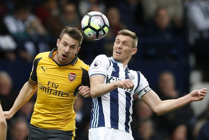 Arsenal's Aaron Ramsey in action with West Bromwich Albion's Darren Fletcher.