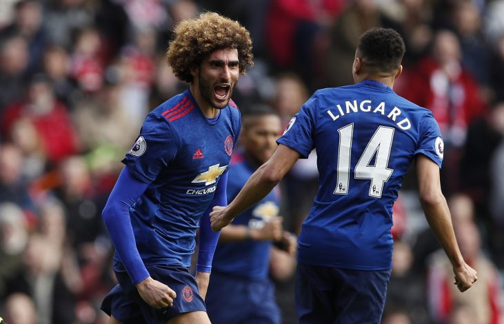 Marouane Fellaini celebrates scoring.