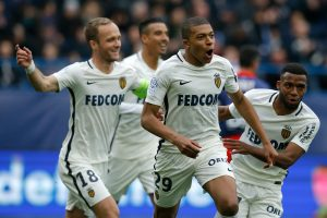 Monaco's Kylian Mbappe celebrates with team mates.