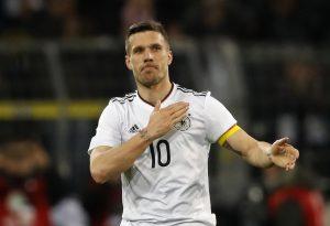 Germany's Lukas Podolski acknowledges the crowd.