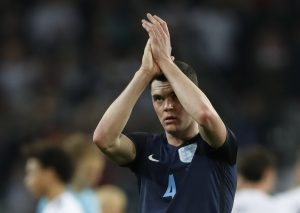 England's Michael Keane applauds fans.