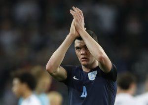 England's Michael Keane applauds fans.