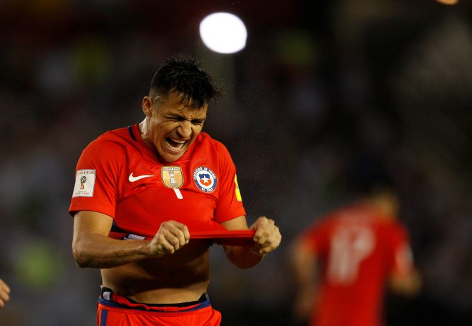 Alexis Sanchez reacts after missing a goal opportunity.