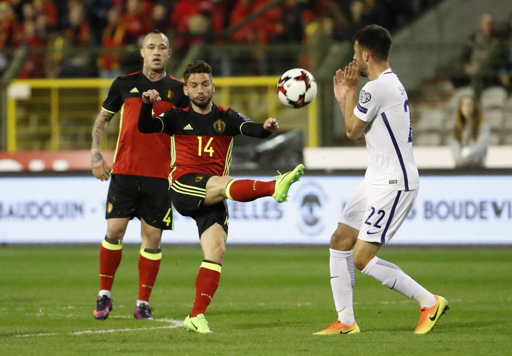 Belgium's Dries Mertens in action with Greece's Andreas Samaris.