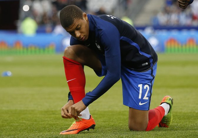 France's Kylian Mbappe warms up before the match.