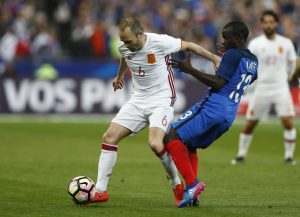 France's N'Golo Kante in action with Spain's Andres Iniesta.