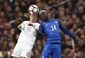 Spain's Thiago Alcantara in action with France's Tiemoue Bakayoko.