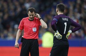 France's Hugo Lloris talks to referee Felix Zwayer.
