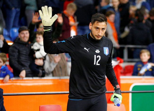 Italy's goalkeeper Gianluigi Donnarumma gestures to fans after the match.