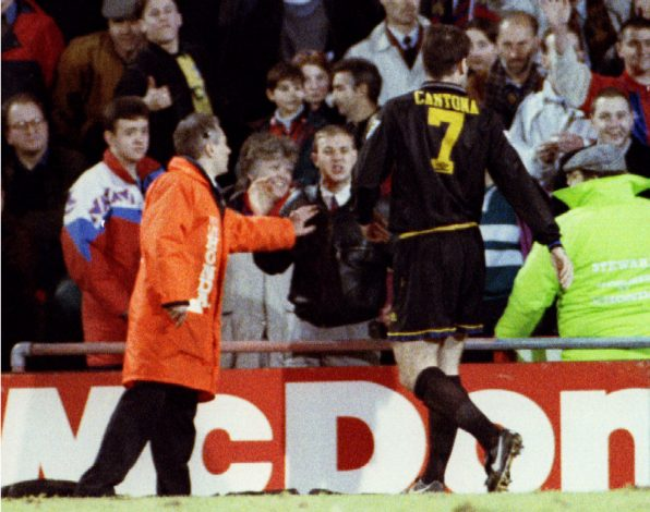 A Crystal Palace fan (C) shouts at Manchester United's French striker Eric Cantona.