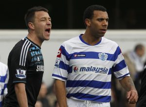 Queens Park Rangers' Anton Ferdinand (R) is marked by Chelsea's John Terry before a corner kick.