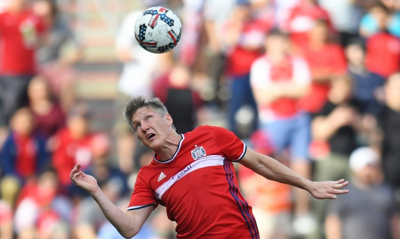 Chicago Fire midfielder Bastian Schweinsteiger (31) heads the ball in the first half against the New England Revolution at Toyota Park.