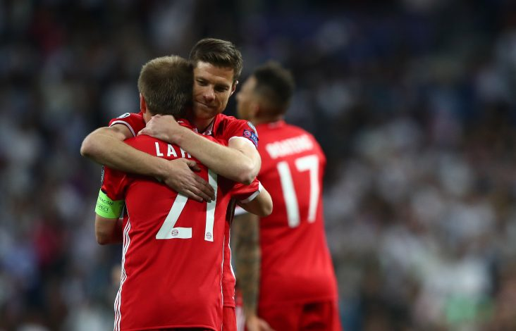 Bayern Munich's Xabi Alonso and Philipp Lahm at the end of the match.