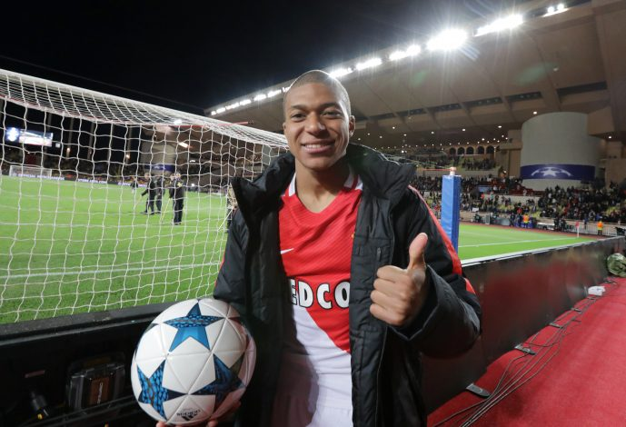 Monaco's Kylian Mbappe-Lottin celebrates after the match.