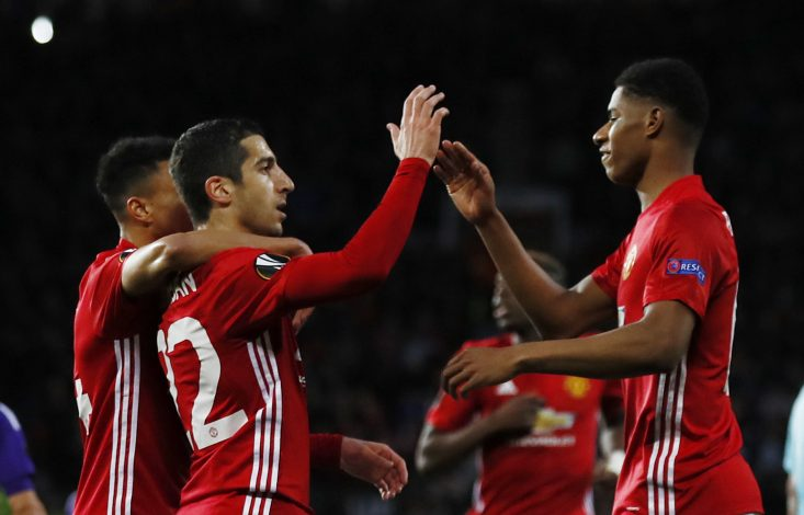 Manchester United's Henrikh Mkhitaryan celebrates scoring their first goal with Marcus Rashford.