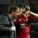 Manchester United's Zlatan Ibrahimovic receives medical attention after sustaining an injury.