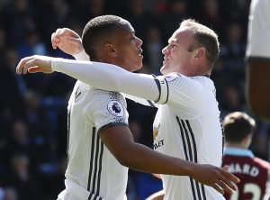 Manchester United's Anthony Martial celebrates with Wayne Rooney after scoring their first goal.