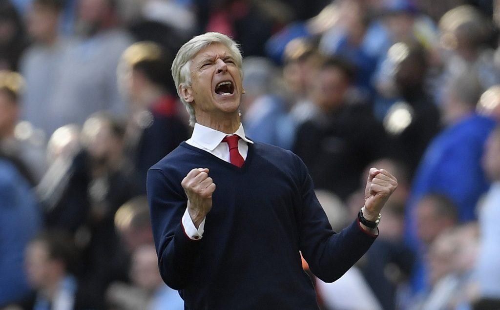 Arsenal manager Arsene Wenger celebrates after the match.
