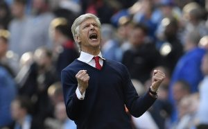 Arsenal manager Arsene Wenger celebrates after the match.