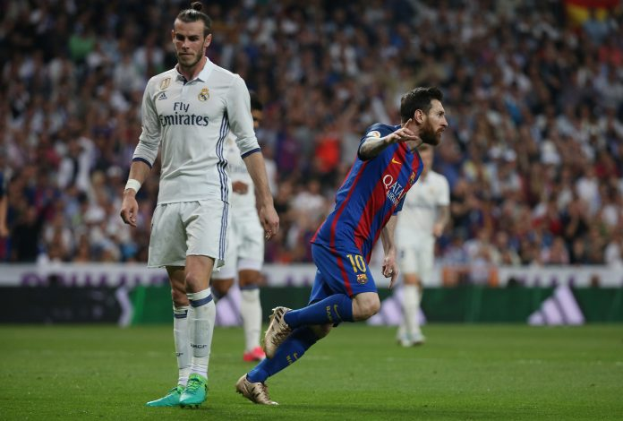 Barcelona's Lionel Messi celebrates scoring their first goal as Real Madrid's Gareth Bale looks dejected.
