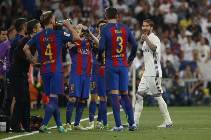 Real Madrid's Sergio Ramos gestures to Barcelona's Gerard Pique after being sent off.