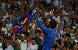 Barcelona's Lionel Messi celebrates scoring their third goal.
