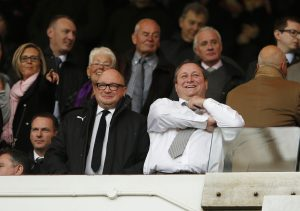 Newcastle owner Mike Ashley (R) in the stands with Managing Director Lee Charnley.