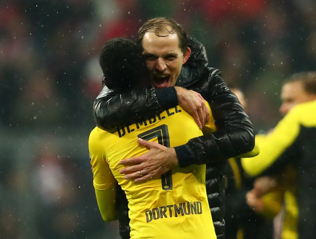Borussia Dortmund coach Thomas Tuchel and Ousmane Dembele celebrate after the match.