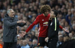 Manchester United's Marouane Fellaini after being sent off with manager Jose Mourinho and fourth official Neil Swarbrick.