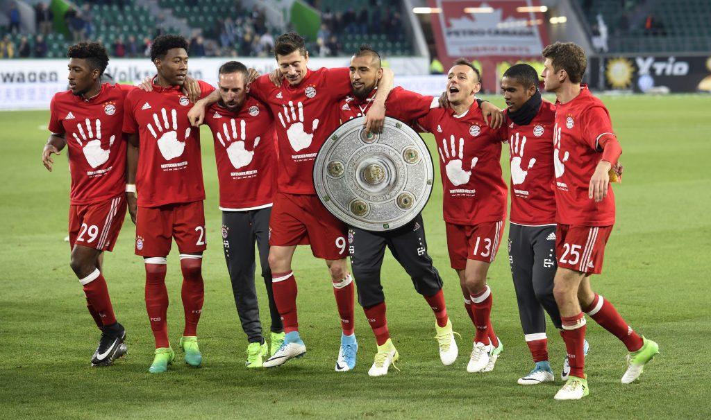 Bayern Munich's players celebrate after the match after winning the Bundesliga.