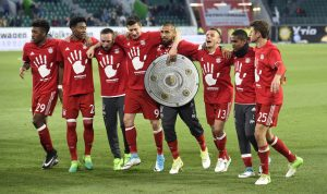 Bayern Munich's players celebrate after the match after winning the Bundesliga.