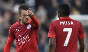 Leicester City's Jamie Vardy talks to Ahmed Musa.