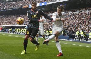 Real Madrid's Gareth Bale in action against Espanyol's David Lopez.