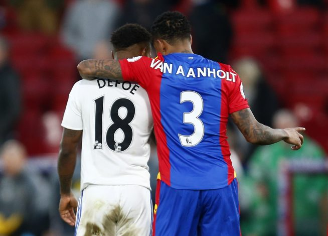 Sunderland's Jermain Defoe talks to Crystal Palace's Patrick van Aanholt.