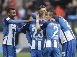 Hertha Berlin's Marvin Plattenhardt celebrates after scoring a goal with his teammates.