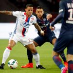 Marquinhos of Paris Saint Germain in action against Memphis Depay of Olympic Lyon.