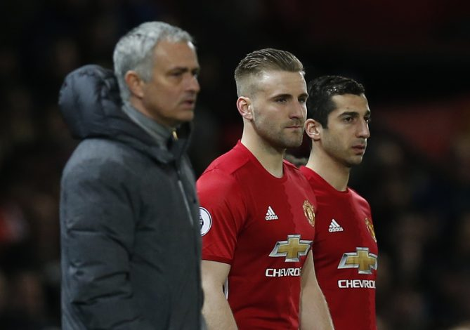 Luke Shaw and Henrikh Mkhitaryan wait to come on as substitutes.