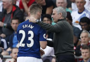 Luke Shaw is congratulated by manager Jose Mourinho as he is substituted.