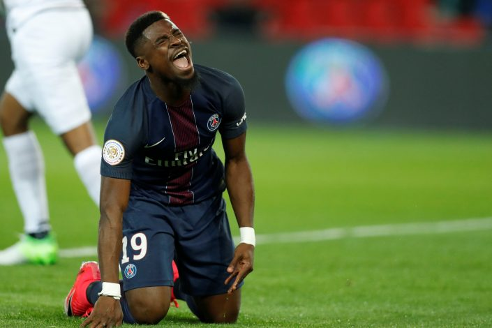Paris St Germain's Serge Aurier reacts.