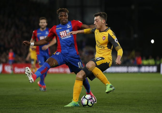 Crystal Palace's Wilfried Zaha in action with Arsenal's Mesut Ozil.