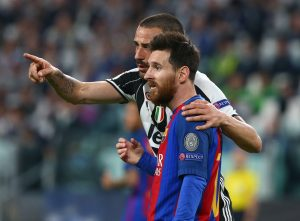 Juventus' Leonardo Bonucci speaks to Barcelona's Lionel Messi.