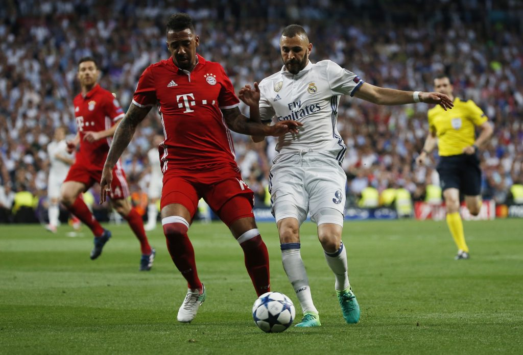 Real Madrid's Karim Benzema in action with Bayern Munich's Jerome Boateng.