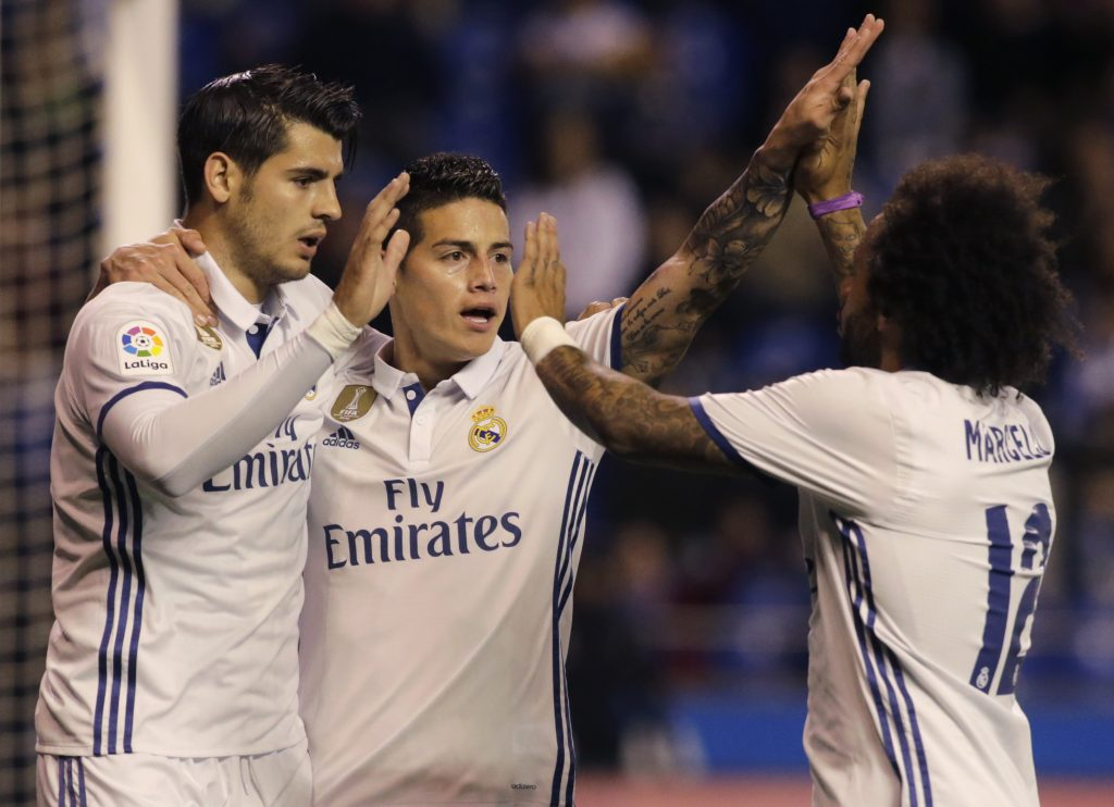 James Rodriguez (C) celebrates a goal with team mate Alvaro Morata (L) and Marcelo.