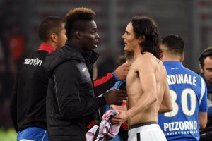 Nice's Mario Balotelli (L) and PSG's Edinson Cavani speak after match.