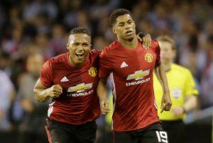 Manchester United's Marcus Rashford celebrates scoring their first goal with Antonio Valencia.