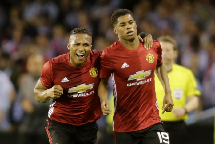 Manchester United's Marcus Rashford celebrates scoring their first goal with Antonio Valencia.