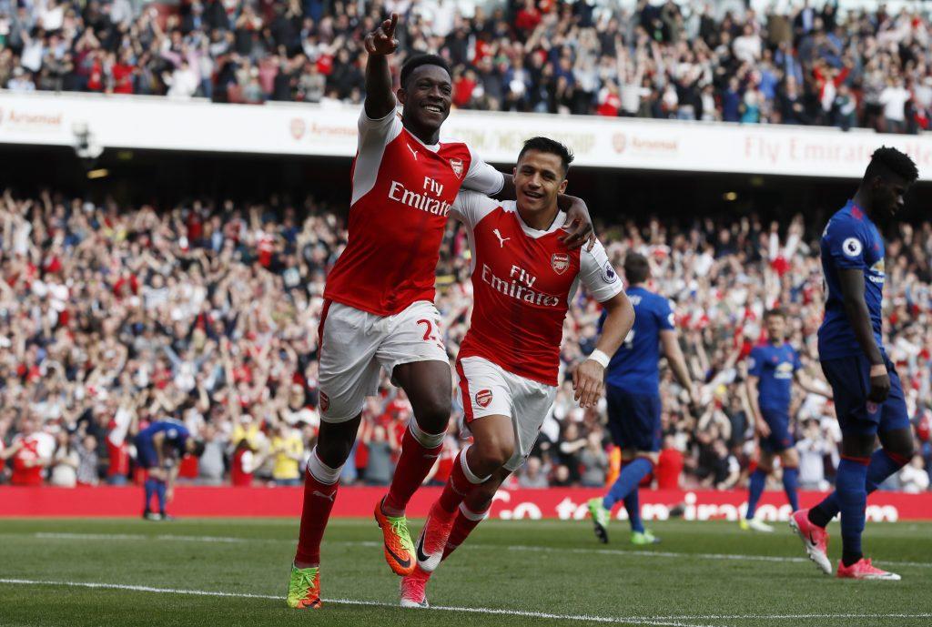 Arsenal's Danny Welbeck celebrates scoring their second goal with Alexis Sanchez.