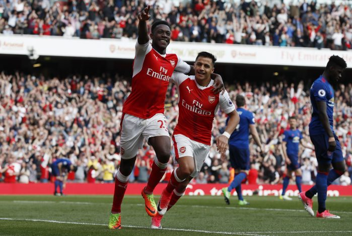 Arsenal's Danny Welbeck celebrates scoring their second goal with Alexis Sanchez.
